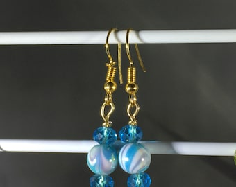Turquoise swirls and crystals. Gold colored French Hooks.