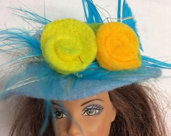 Very pretty pale blue hat for Barbie with flower and feather trimmings. OOAK hand made felt hat for 12inch fashion doll. Barbie accessories.