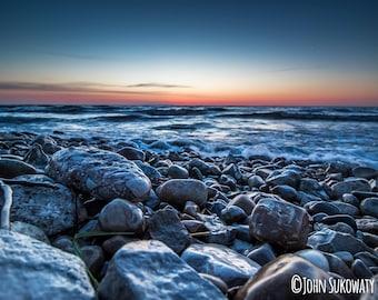 Foreground Rocks and Fantastic Colorful Sunrise Over Lake Michigan