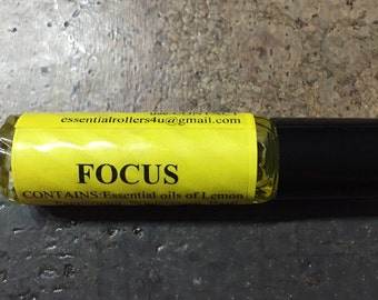 FOCUS essential oil 10ml rollerball blend: Lemon, Peppermint, Wintergreen, Basil, Rosemary, Grapefruit, & Fractionated Coconut Carrier oil.