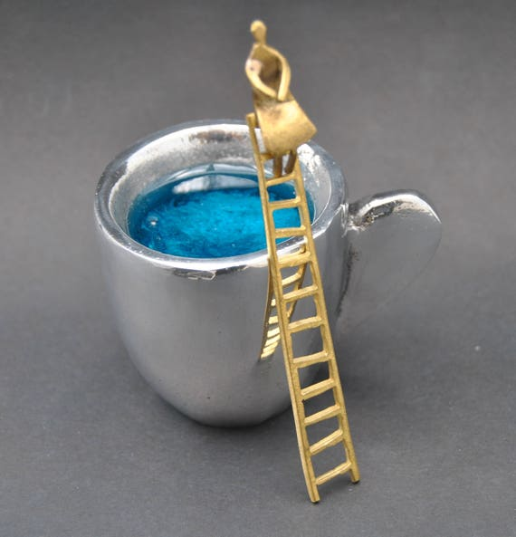 Decoration item, handmade. Aluminum  and brass figures. The color inside the stone is made of glass.