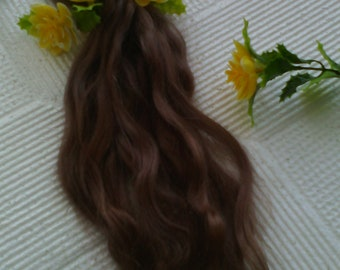 Premium mohair for doll hair. The color is brown . Length 23 to 26 cm or 9 - 10 inch.