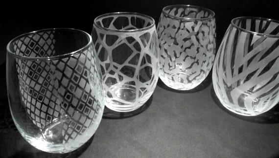 & Wine glasses hand etched with animal print. Stemless wine