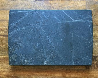 small cheese or serving board in black soapstone 9x13