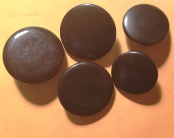 Five miscellaneous large round black buttons