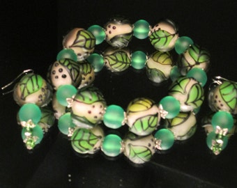 Unusual and Gorgeous Stretch Bracelet and Matching Pierced Earrings