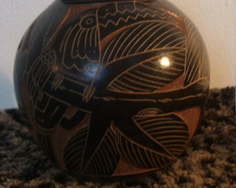 Hand Carved Toucan bird On Clay Pottery From Jamacia sale