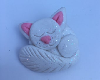 White and pink sleeping cat brooch