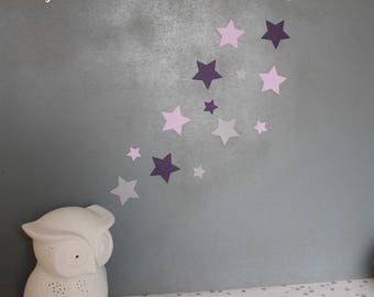 Set of stars for wall decoration in purple tones