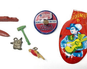 Vintage Crackerjack toys prizes metal top boat train plastic cow Japan