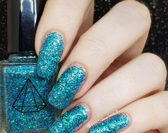 Sun Glitter - a turquoise holo glitter filled with colour shifting glitters and shimmer UK handmade indie nail polish