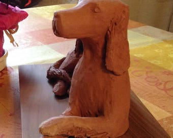sculpture of a dog in Terra-cotta Red