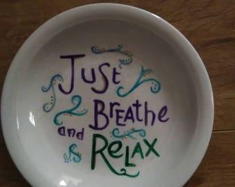 Hand painted white ceramic plate.