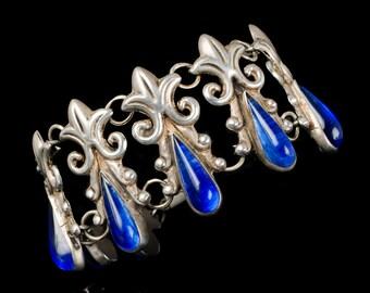 Mexican Deco silver repousse Bracelet, fleur-de-lis with azur blue art glass