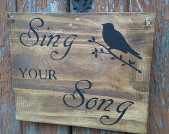 """Sing your song"" sign"