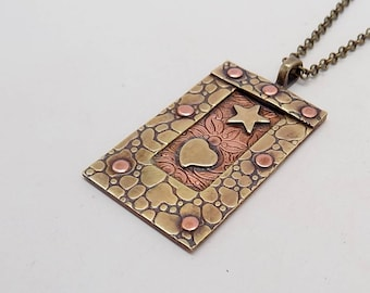 Mixed metal steampunk jewelry necklace pendant. Steampunk jewelry