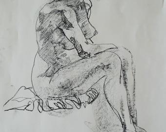 Conté crayon life drawing of a woman sitting