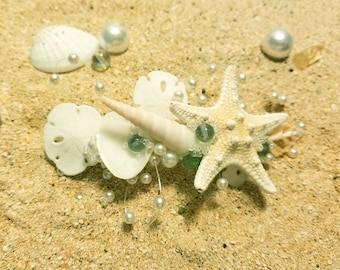 A Mermaid's Delight of Seafoam Green beads with pearls, knobby sea star and small sand dollars
