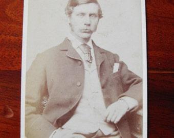 Carte de Visite of a man with moustache, sitting 1880