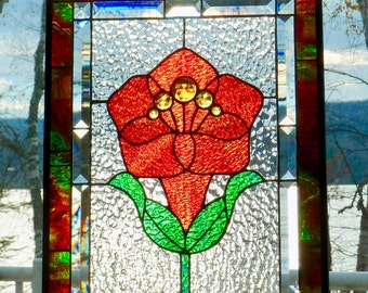 A glazing and vivid stained glass flower panel.