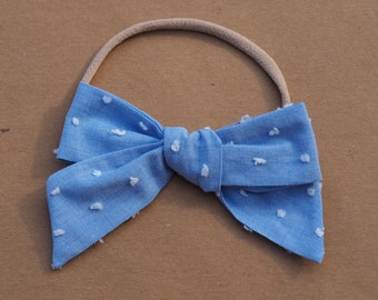 Chambrey swiss dot oversized bow