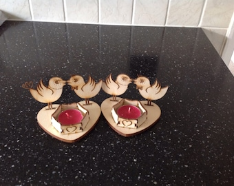Two love bird tea light holders