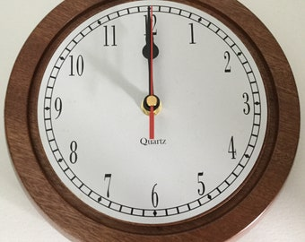 Unique African Sapele quartz wall clock 215mm in diameter.