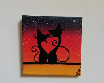 Couple of cats in love on Sunset with rain of stars