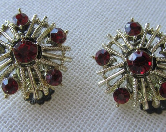 Vintage silver tone clip on earrings with red rhinestones