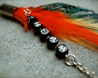 One sided  Feather earring with DREAM letter beads.