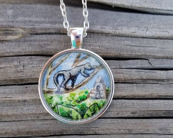 Howler Monkey necklace. Hand-painted money with Mayan ruins in the Guatemalan jungle in the background. Monkey necklace, watercolor and ink