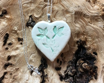 Ceramic heart pendant with a silver plated chain