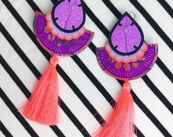 PURPLE GLITTER EARRINGS with neon coral tassels. U.V. Reactive, statement festival jewellery. Fluorescent tassel earrings.