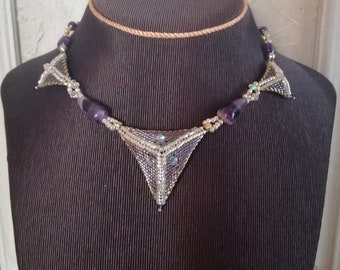 Handmade hand-sewn necklace with glass beads, Swarovski and streaked Amethyst