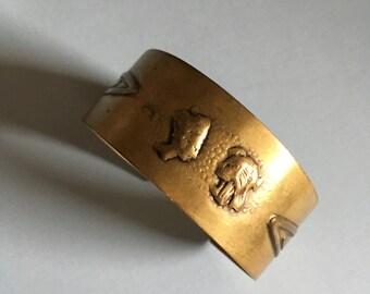 Brass Repousse Egyptian Revival Pharoah Cuff Bracelet 1970s