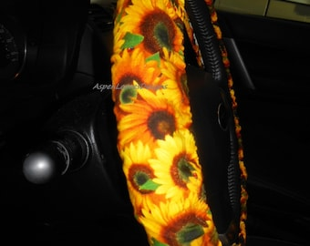 Sunflower Steering wheel cover. Red ladybugs and large sunflowers on green. Fully lined with matching seat belt covers and key fob.