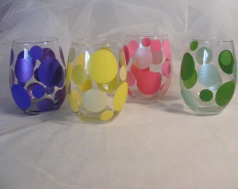 painted stemless wine glasses with large colorful polka dots- both pastel and bold colors