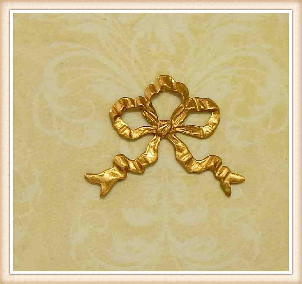 2 pieces brass bow miniature swag raw brass vintage