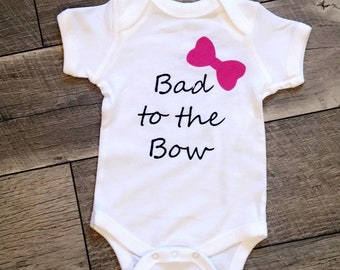 Bad to the Bow onesie or tee