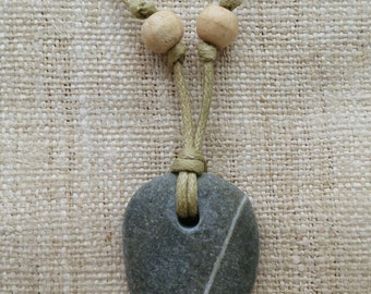 Beach pebble with natural mineral line