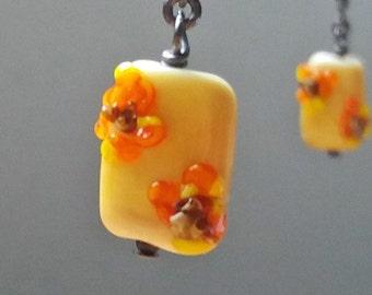 Short double Sunflowers Earrings. Lampworked glass on oxidised silver