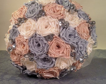 Pastel blush, ivory, silver and crystal satin rose wedding bouquet