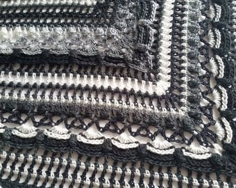 Crocheted ' lost in time ' shawl , black/white/grey