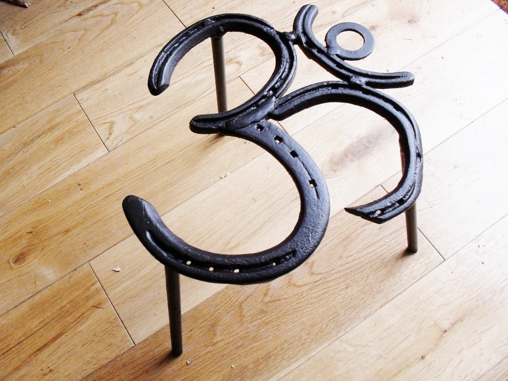 Om symbol recycled metal horse shoe trivet for cooking on a zoom buycottarizona Gallery