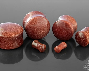 "DF Red Goldstone plugs 6g, 4g, 2g, 0g, 00g (9.5mm), 7/16"", 1/2"" (13mm), 9/16"", 5/8"", 3/4"", 7/8"", and 1"""