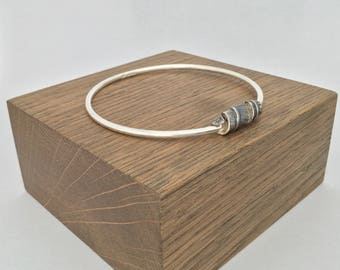 Silver bangle with folded twisted oval, hallmarked
