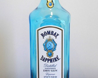 Turquoise Bombay Sapphire gin bottle, with lid. Make a lamp base or candle holder. Breweriana, pub, inn, bar decor. Crafts. Kitchen storage
