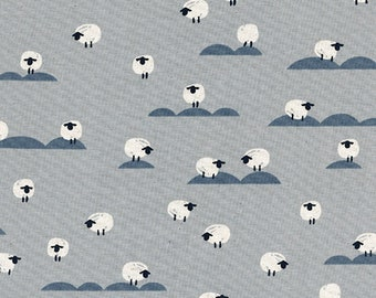 Sheep in Newspaper by Melody Miller and Sarah Watts from the Panorama collection for Cotton and Steel #5169-01 by 1/2 yard