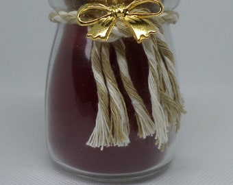 Red Candle in bottle with cork lid