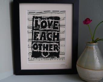 Love Each Other Original Linoprint on Vintage Sheet Music